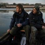 Hungarian fishermen Attila Solyomvari, left, and Tibor Osze, right, look at the River Danube near Gyor. The mighty Danube apparently absorbed Hungary's massive red sludge spill with little immediate damage Friday but laboratory tests heightened concerns about possible longer-term harm caused by toxic heavy metals in the slurry.