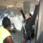Demonstrators smash the windows of Millbank Tower, in Westminster, central London as students and teachers gathered in central London to protest against university funding cuts and Government plans to charge up to 9,000 per year in fees from 2012.