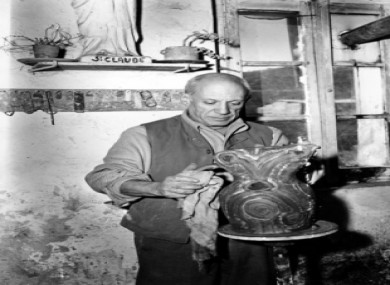 Pablo Picasso, 66, paints an urn in the pottery workshop of Madame Ramie at Vallauris on the French Riviera, 1948.
