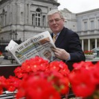 Labour Leader Eamon Gilmore happily peruses The Irish Times after an opinion poll in the paper in June showed Labour had become the most popular party in the country for the first time ever.