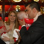 Azzedine  Benhaffaf kisses his son Hussein as his wife Angie holds his twin brother Hassan during a civic  function at Cork City Hall  for the two boys who underwent a 14-hour long operation to separate them at the Great Ormond Street Hospital in London last year.