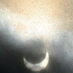 A partial solar eclipse is seen through clouds and snow flurries on Vodno Mountain near Skopje, Macedonia, on Tuesday, Jan. 4, 2011. 