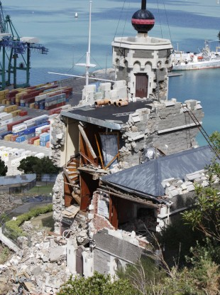 The iconic Time Ball Station stands semi-destroyed following Tuesday's earthquake in Lyttelton on the outskirts of Christchurch, New Zealand