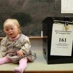 One-year-old Rose Verveen quite sensibly doesn't have her head turned by the action around her at a polling station in Glenealy, Co Wicklow today. Pic: Julien Behal/PA Wire