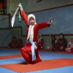 An Afghan girl practices the martial arts with a sword at a Wosho training club in Injil, Herat province, Afghanistan.