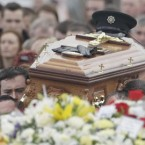The coffin of PSNI Constable Ronan Kerr, killed in a car bomb last weekend, is carried through his home town of Beragh in Co Tyrone. Pic: Niall Carson/PA Images