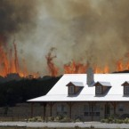 A wildfire threatens a house near Possum Kingdom, Texas. Image: AP Photo/LM Otero