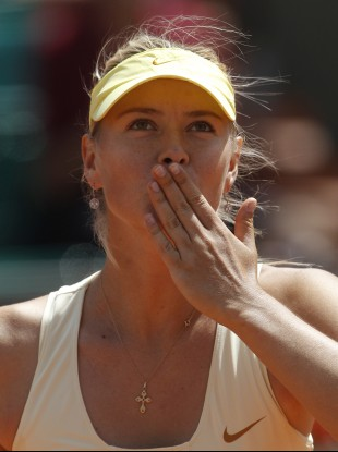 Maria Sharapova blows a kiss to the public after defeating Croatia's Mirjana Lucic today.