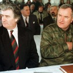 In this undated file photo Bosnian Serb Leader Radovan Karadzic and General Ratko Mladic attend an assembly session near Sarajevo.