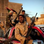 Rebel fighters act as security in downtown Benghazi, Libya. (AP Photo/Rodrigo Abd)