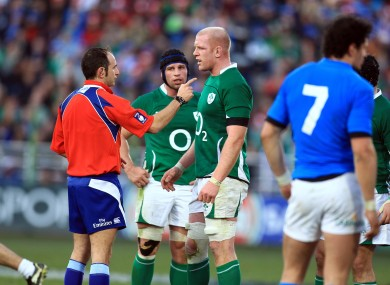 Romain Poite lectures Paul O'Connell during Ireland's Six Nations clash with Italy.