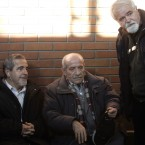 Milan Lugonja (left), Ratko Vucetic (centre) and Stanko Ristic, three of the people accused of helping Mladic evade justice, converse in a Belgrade courtroom in December 2010.