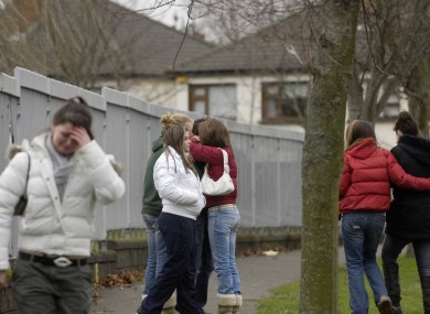 Friends of Lynsey O'Brien react outside her school after finding out about her death.