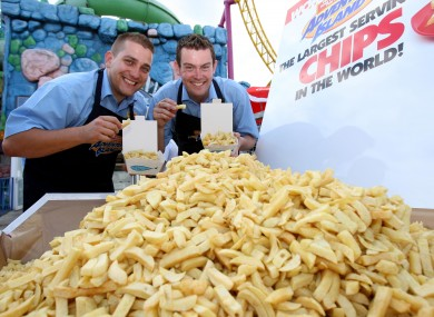 Catering Manager Gregg Smith (left) and Head of Catering James Gibbs smile, after breaking the current weight of 368.5 kg of the Guinness World Record for the biggest portion of chips ever served, at Adventure Island, Southend-on-Sea, Essex.