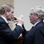 Taoiseach Enda Kenny and Tanaiste Eamon Gilmore compare shadow puppets (possibly) at the launch of a visa waiver programme (Eamonn Farrell/Photocall Ireland)