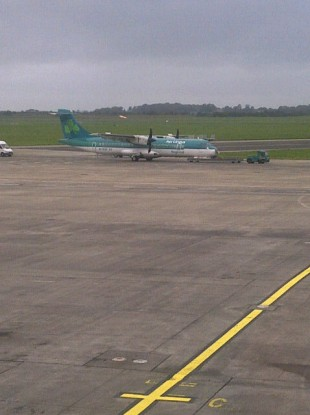 The Aer Arann aircraft, carrying Aer Lingus branding, is towed away at Shannon airport this afternoon.