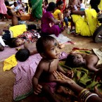 An Indian mother feeds her child in the eastern city of Bhubaneswar (AP Photo/ Biswaranjan Rout)