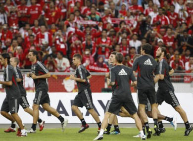 Liverpool train in front of their Malaysian fans - not an AON or AIG logo in sight.