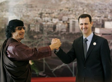 File photo of Libya's Gaddafi meeting Syria's Assad in 2008. Turkey has warned Damascus that it will suffer the same fate as Tripoli if Assad does not