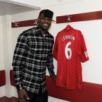 LeBron with his new Liverpool jersey. Does Fabio Aurelio know that he's been given the boot?