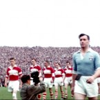 The Dublin and Derry teams parade before the 1958 All-Ireland final.
