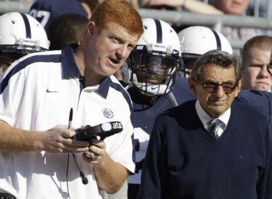 Penn St assistant football coach Mike McQueary, left, talks with then head coach Joe Paterno.