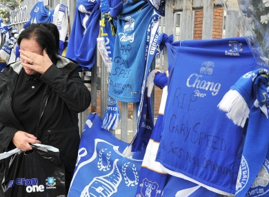 An Everton fan pays her final respects to Speed.