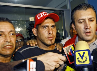 Ramos (centre) after he was found.