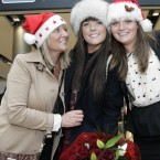 Pictured are mother Cathy Sammon and sister Seana, left, welcoming back Aoidin who arrived home for Christmas to Dublin Airport from London where she moved earlier this year. Photo Mark Stedman/Photocall Ireland