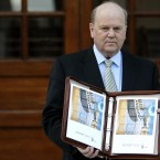 Finance Minister Michael Noonan in Government Buildings with the budget folio during the second day of the Irish Budget. Photo: Julien Behal/PA Wire
