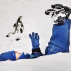 Two-year-old Ethan Woodley enjoys playing in the snow in Whitburn, Scotland, following fresh snow falls overnight.
