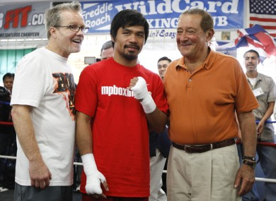 Pacquiao with trainer Freddy Roache (left) and promoter Bob Arum (right)