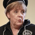 For some reason the German chancellor thought it was an 'informal fancy dress meeting'. It isn't... (AP Photo/Mircea Rosca)