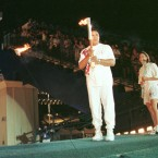 Muhammad Ali and Janet Evans with the Olympic flame in Atlanta in 1996.