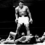 Champion Muhammad Ali stands over Sonny Liston and taunts him to get up after knocking him down in the first round.