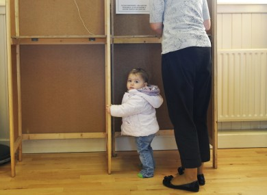 Síofra Hughes, 1, waits as her mother Siobhán votes in October's presidential election.