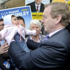 Enda Kenny pictured 8 month old Emma Brady in a GE11 walkabout in Crumlin. (Photograph: Sasko Lazarov/Photocall Ireland)