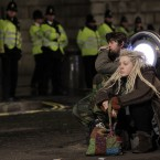 Two Occupy London protesters look on from the middle of the road outside St Paul's Cathedral in London after bailiffs moved in to remove tents from the Occupy London camp. Photo: AP Photo/Sang Tan