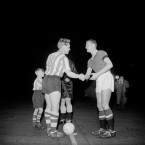 Man Utd's new captain Billy Foulkes, right, shakes hands with Sheffield Wednesday skipper Albert Quixall before the kick off in the FA Cup tie at Old Trafford. Utd beat Wednesday 3-0 in their first game after the disaster.