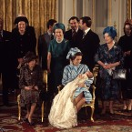 1977 ended with the Queen getting her first grandchild: Princess Anne, who had been the first of her four children to marry (to Captain Mark Phillips in 1973), gave birth to Peter Mark Andrew Phillips. Here the Royals are pictured in the White Drawing Room at Buckingham Palace.