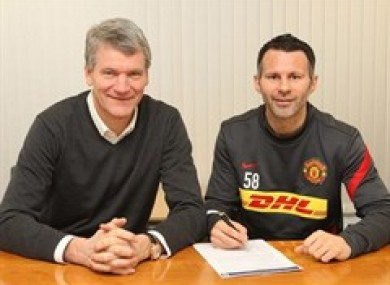 Giggs signs on with with chief executive David Gill.
