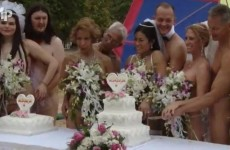 Video: Naked couples tie the knot in mass beach wedding