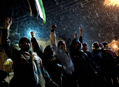 Free Syrian Army supporters chant anti-government slogans under snowfall on the outskirts of Idlib in the north of the country