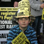 Patrick Doorhy (8) from Galway outside the Convention Center in Dublin, protesting over the household charge. Photo: Sam Boal/Photocall Ireland