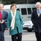 Joe Cuddy (left) arrives with Frank Kelly (right) and his wife Barbara (centre). 