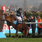 Richard Johnson can't stay on Wishfull Thinking during a dramatic Queen Mother Chase. Pic:Tony Marshall/EMPICS Sport