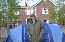 Evicted couple set up tent outside former home