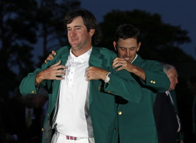 Bubba Watson tries on the famous green Augusta Masters blazer