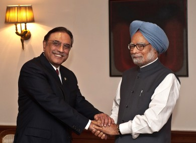 Zadari shakes hands with Singh at the prime minister's residence in New Delhi today.