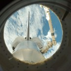 A glimpse of Earth over Discovery from the ISS in September 2009. (Image: NASA)